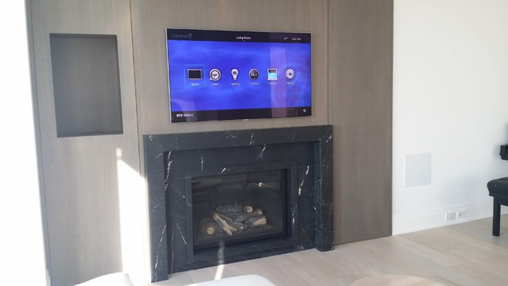 Entertainment system controlled by Control4 in a condo apartment